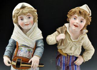 2 Antique Bisque Porcelain Tall Figurines Boy Girl Hurdy Gurdy 18""