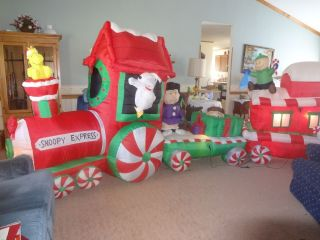 gemmy airblown inflatable peanuts snoopy train express 15 ft long christmas deco