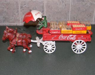 Coca Cola Cast Iron Horse Drawn Wagon with Miniature Bottles Crates