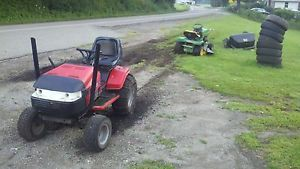 Huskee Riding Mower 18 HP with Snow Plow and Tire Chains