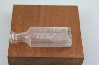 """Antique Drug Store Bottle San Jose Cal """"C w Dore Reliable Druggist"""""""